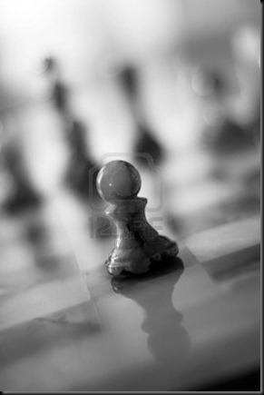 706941-lone-pawn-on-a-chess-board--slighty-grainy-bw-image-shallow-dof